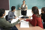 an instructor teaching a small group of professionals